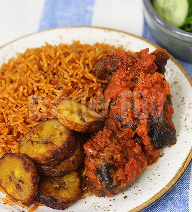 Jollof rice, stewed beef, fried plantain